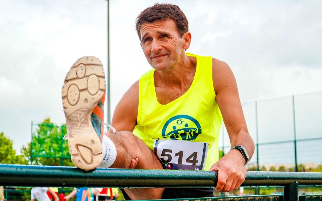 man stretching before a race