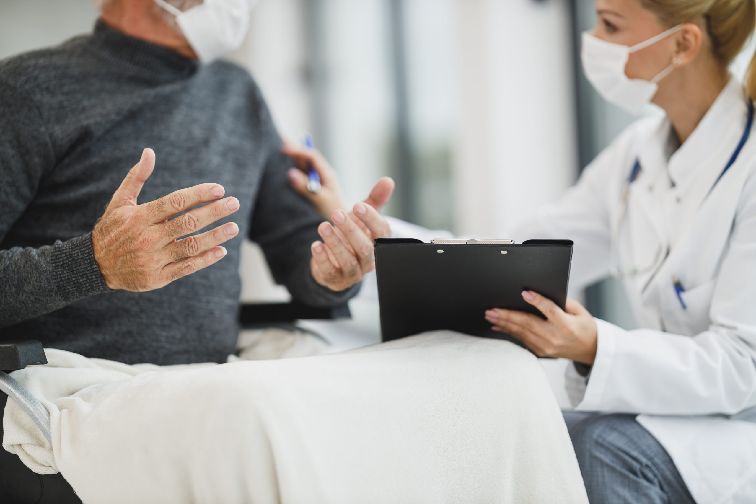 Caregiver Discussing Options with Patient