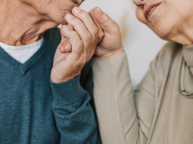 Elderly Couple Holding Hnads